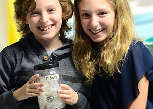 Children with jar of insects